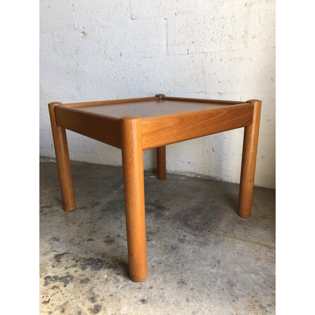 Vintage Mid Century Danish Modern End Table. Features a beautiful wood grain, round legs, and minimalist Scandinavian...