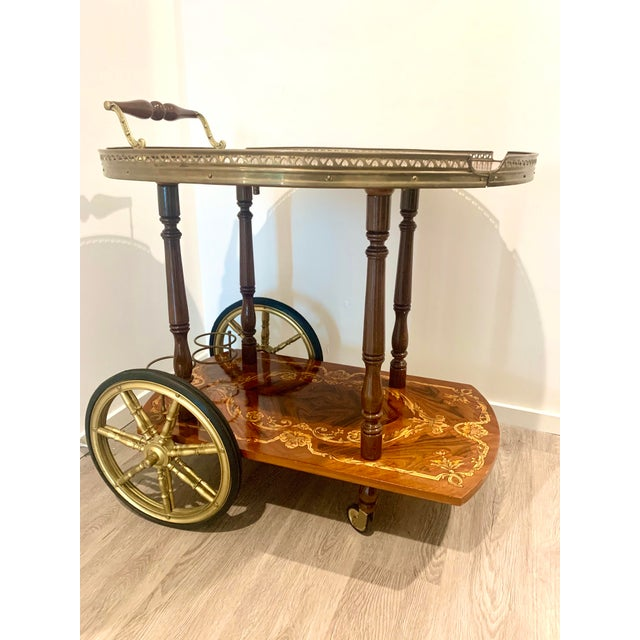 Made between the 50's to 70's. This vintage Inlay marquetry wood Italian Bar Cart features exquisite florentine style...