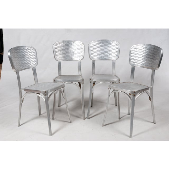 Set of four light weight vintage chairs by Gaston Viort circa 1960's. These chairs are great for indoor or outdoor use....