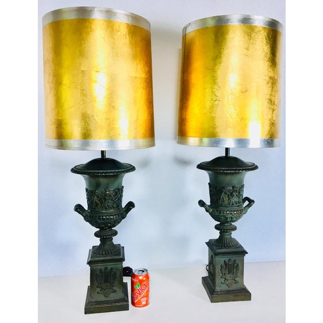 This is a pair of mid century lamps and a classical Romanesque style. These lamps are made of pewter with a patinated...