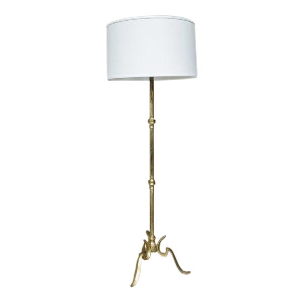 Brass Floor Lamp With a Cast Tripod Base For Sale