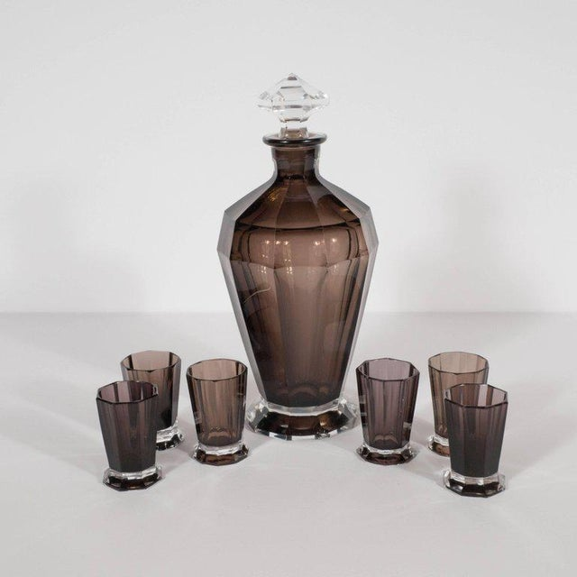 This elegant Art Deco bar set includes six shot octagonally cut and conically shaped decanter and six shot glasses that...