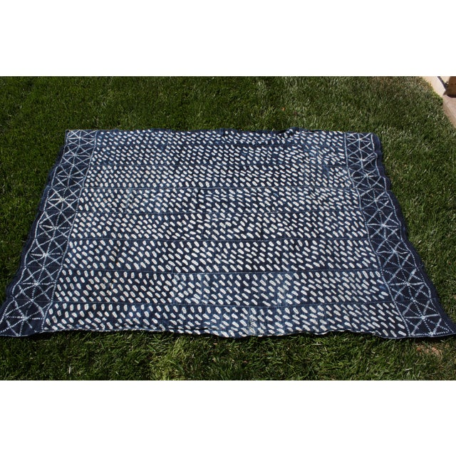 This vintage hand-loomed cotton textile from West Africa is dyed indigo and suitable for use as a throw or fabric for...