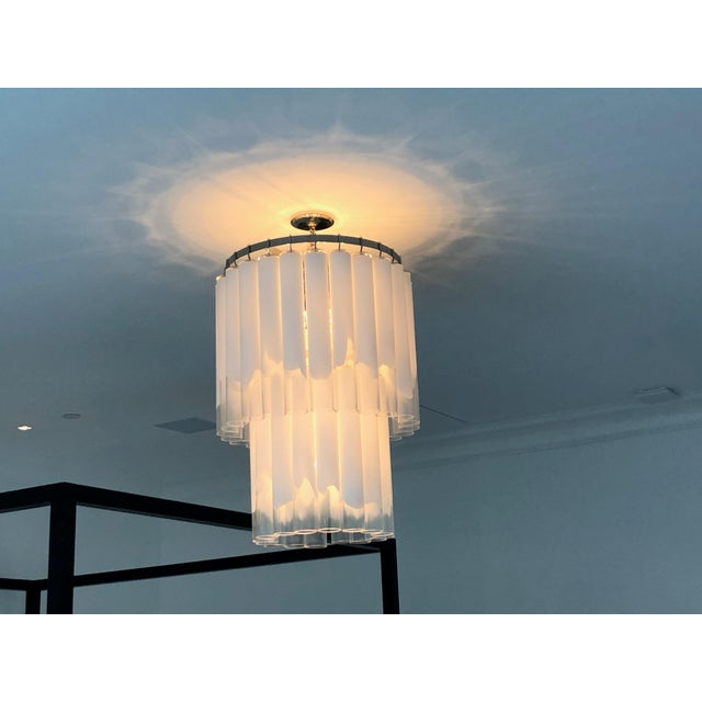 Beautiful Hudson Valley Lighting glass chandelier that features tubes of glass which are opal at the top and raggedly give...