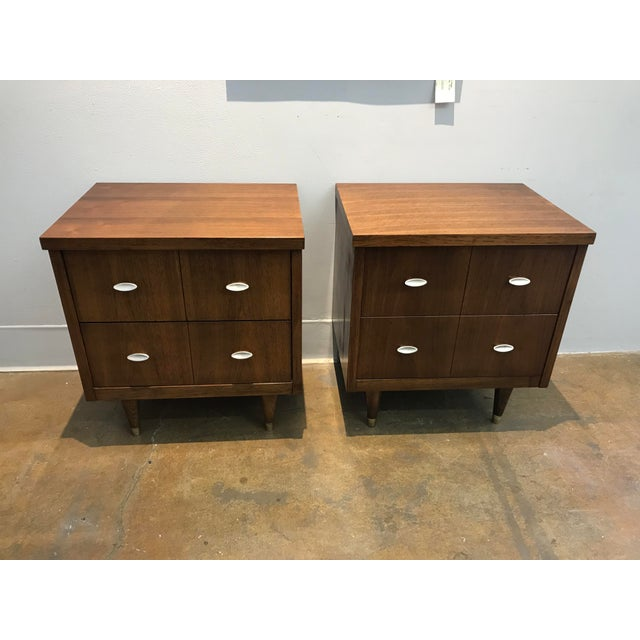 Mid-Century Modern Walnut nightstands with brushes nickel pulls and dovetail joinery.