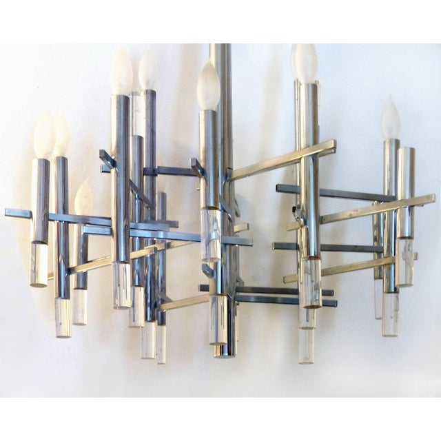 Gaetano Sciolari Italian Modernist Chrome Chandelier Offered for sale is a 1970s modernist chandelier by the Italian...