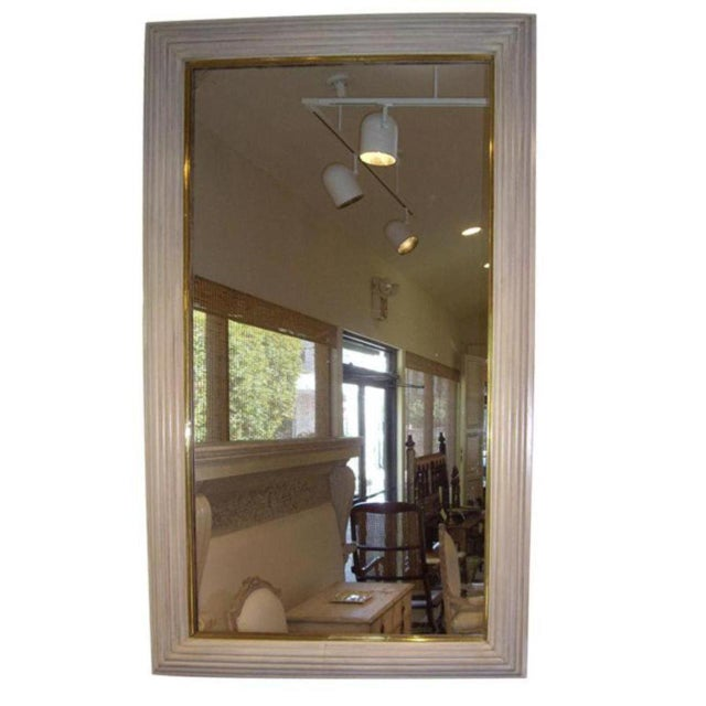 Parchment finish and brass Art Deco / Moderne French mirror. Circa 1940.