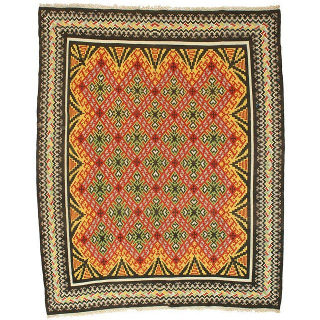 """A colorful antique kilim rug in green, red, and yellow. measurement: 9'8"""" x 11'10"""""""
