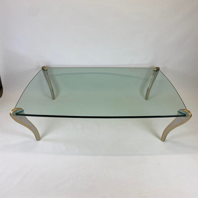 An amazing piece of American studio furniture by Peter Handler. Mixed metal sculptural legs attached to a thick shaped...