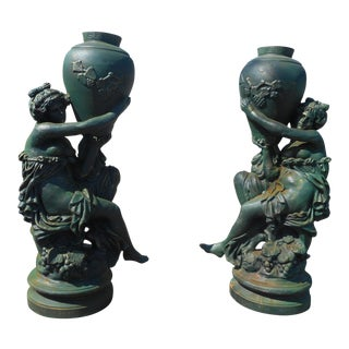 Pair of Cast Iron Women Holding Urns Statues For Sale