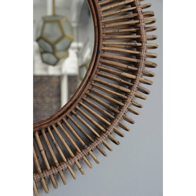 """Single 'Oculus' round rattan mirror by Design Frères. Diameter of the inner mirror panel is 17.5"""" inches."""