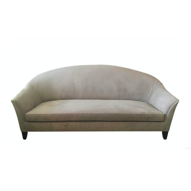 Beautiful three-seat sofa with a curved back. Upholstered in a Todd Hase gray velvet fabric with self welt detail....
