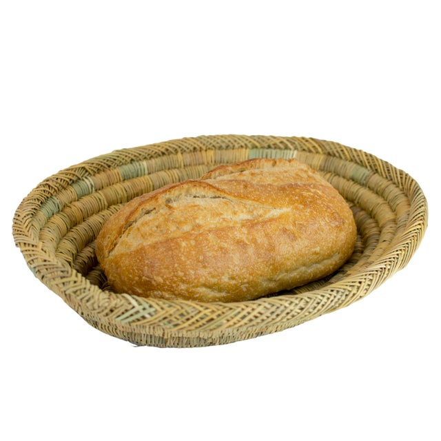 Hand-woven with palm leaves, this oval bread basket is durable and sustainable. Use this basket for bread, fruits,...