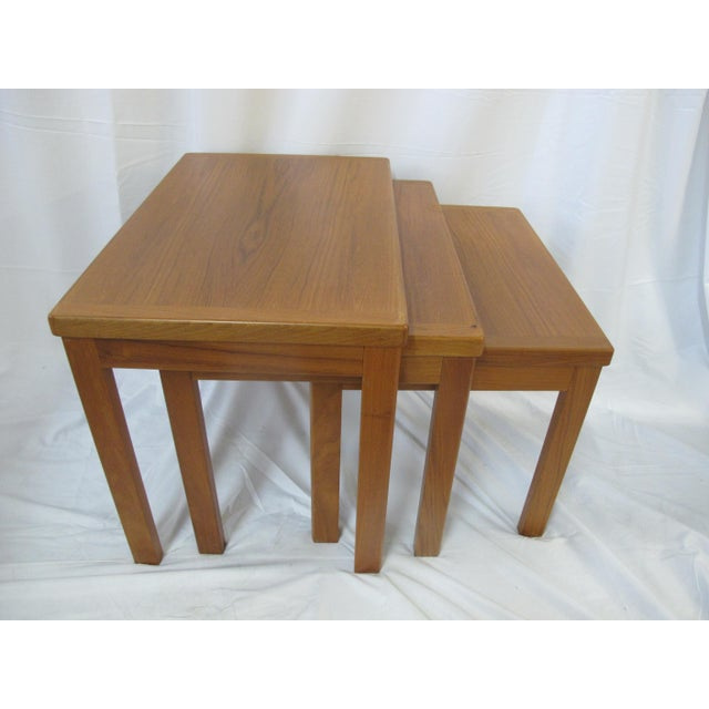 "Fantastic three piece nesting table set by Vejle Stole Mobelfabrik, Denmark. Measurements: Large - 24"" x 18"" Tall x 15.75""..."