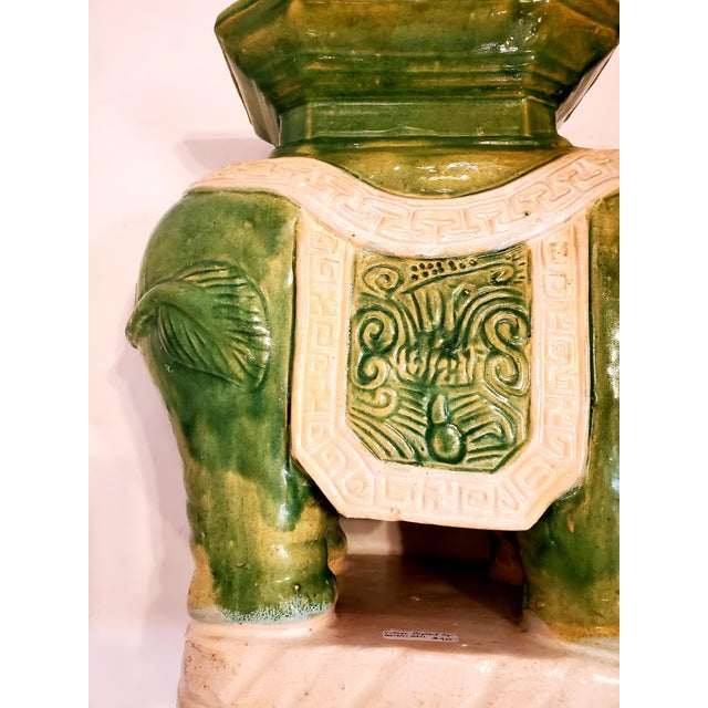 Stylish indoor outdoor ceramic garden seat in the shape of an elephant having octagonal table surface and versatile green...