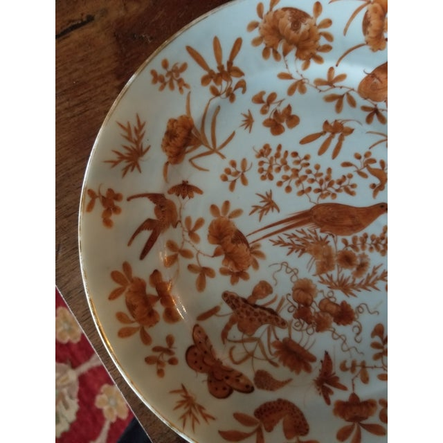Beautiful antique Chinese Export porcelain plate in the sacred bird and Butterfly pattern with worn gold edge.
