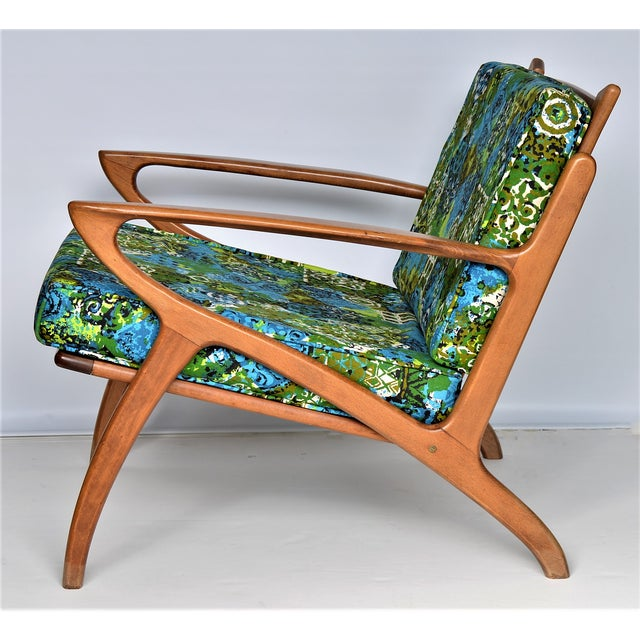 Offering an authentic Mid Century Danish Modern vintage teak lounge chair, circa 1960's. This SOLID teak chair is not...