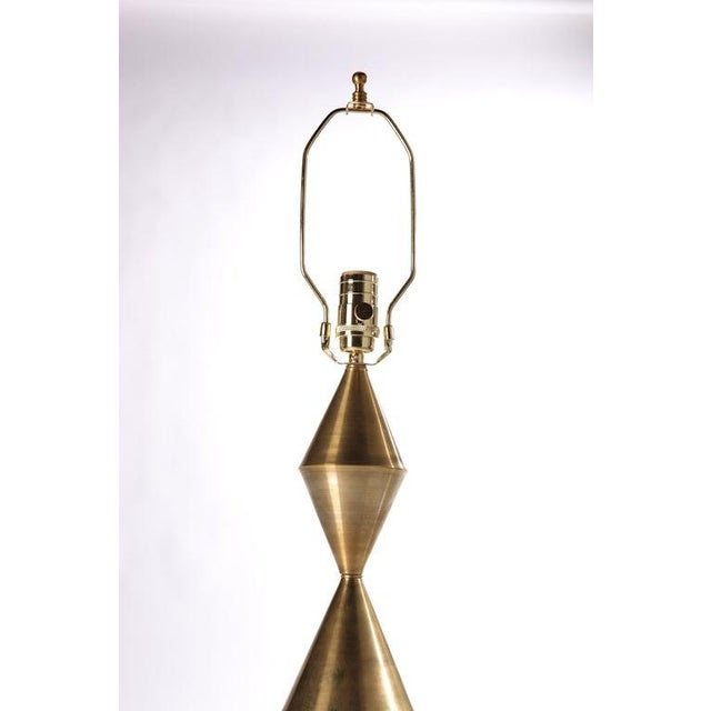 Pair of hand wrought conical brass table lamps, available in brass, antique patinated brass, and gunmetal finishes. Lamp...