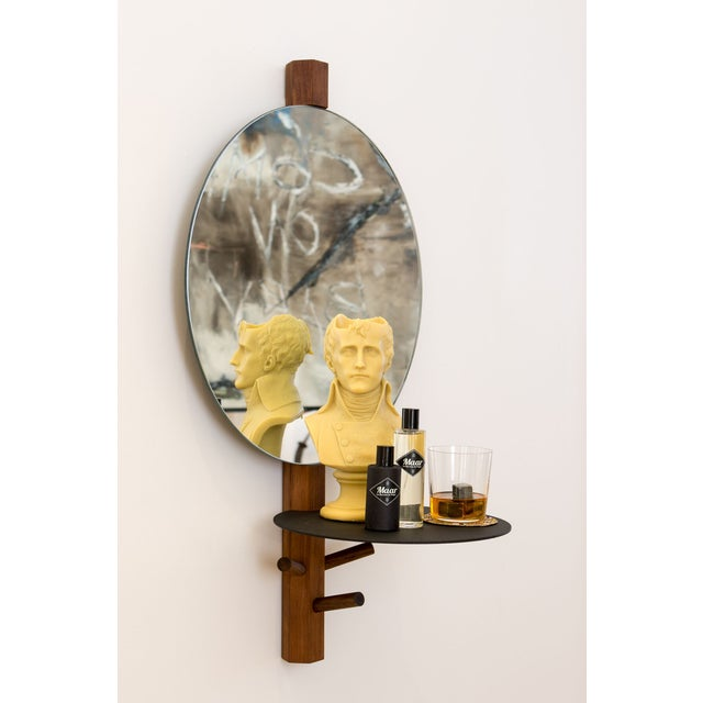 Handcrafted wood and metal structure hanging mirror with plate.