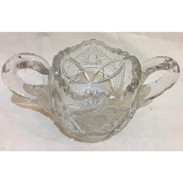A wonderful vintage Mid-Century ornate cut glass sugar bowl with handles. A beautiful design. In good shape. A great...