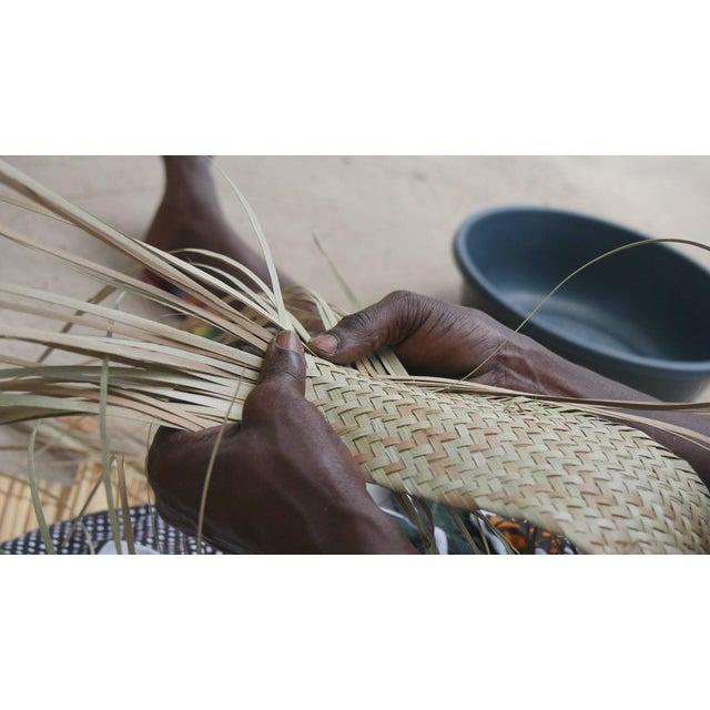 These mats, called esteiras (Portuguese) or ntato (Moniga), were woven by the lovely artists of Estrela Vermelha de...