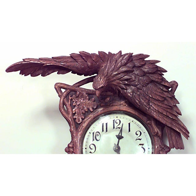 Rustic Black Forest (19th century) walnut wall clock with carved floral decoration and bird pediment with five shelves...