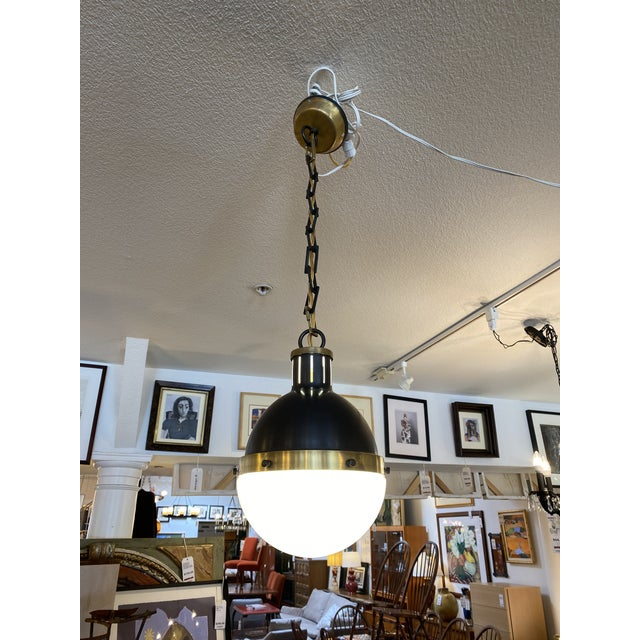 Design Plus Gallery presents the Hicks Pendant by Circa Lighting. Designed by Thomas O'Brien, the divided orb is half...