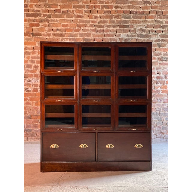Haberdashery drapers shop display cabinet mahogany loft style, circa 1940 We are delighted to this magnificent early 20th...