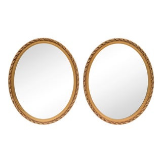 Pair of Oval Oak Leaf Giltwood Mirrors For Sale