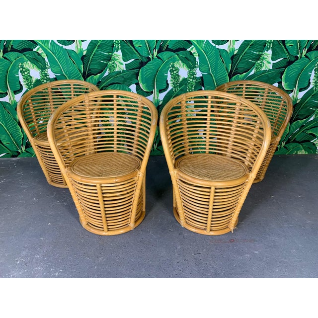 Rattan barrel dining chairs feature a unique horizontal rattan construction. Set of 4. Good condition with imperfections...