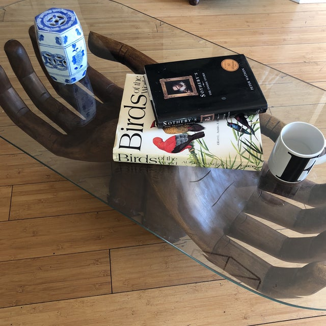 Gorgeous handcarved wooden hands coffee table with detail on fingernails and palms. The open hand depicts friendship,...