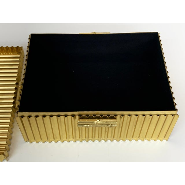 This is the large, Brass Corrugated Bamboo Box by Global Views. These handmade solid brass boxes are powder coated and...