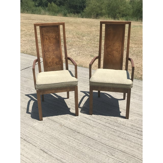 A beautiful pair of high back burled wood dining chairs by Thomasville. Well-cushioned on the seat, with a stylishly...