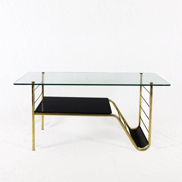 Coffee table, brass structure, glass, black opaline and bronze hardware, black metal magazine rack. Design: Pierre...