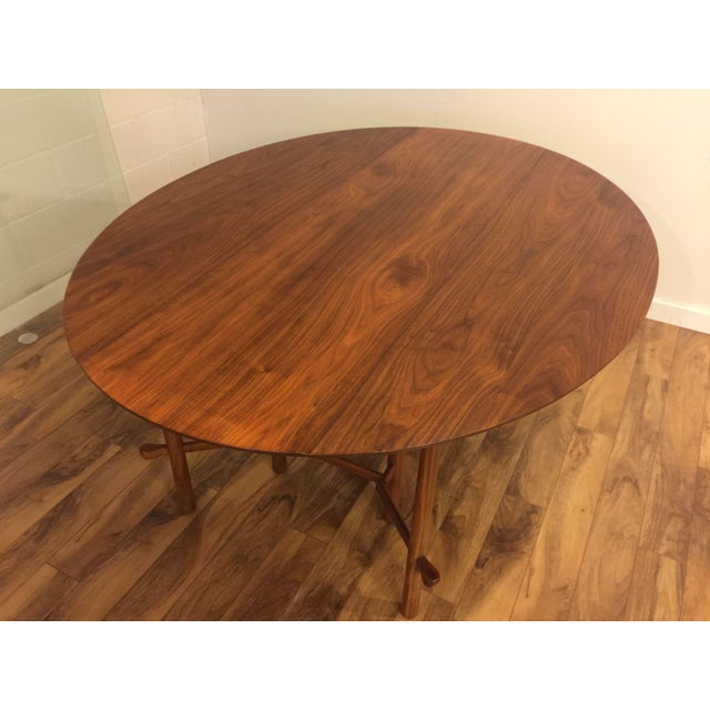 Stunning mid-century drop leaf dining table by Heritage Henredon circa 1960's. This is like a piece of functional art,...