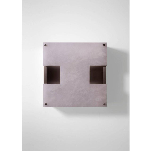 This contemporary light made of brushed nickel and alabaster is part of the Orphan Work brand and can be used as a wall...