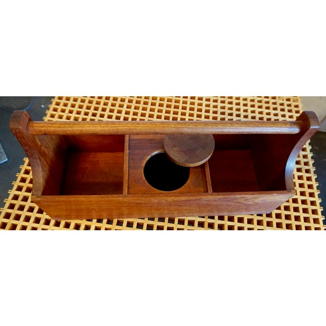 Solid teak in the shape of a toolbox with a covered ice bucket.The brass toolbox contains a corkscrew,bottle opener and...