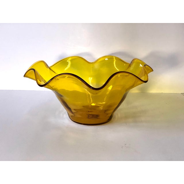Midcentury handblown art glass handkerchief bowl with ruffle edges in the vivid amber yellow color. Would make a great...