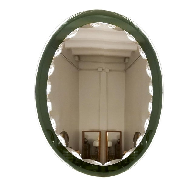 Beveled mirror with a green beveled mirror frame. Italy c. 1960