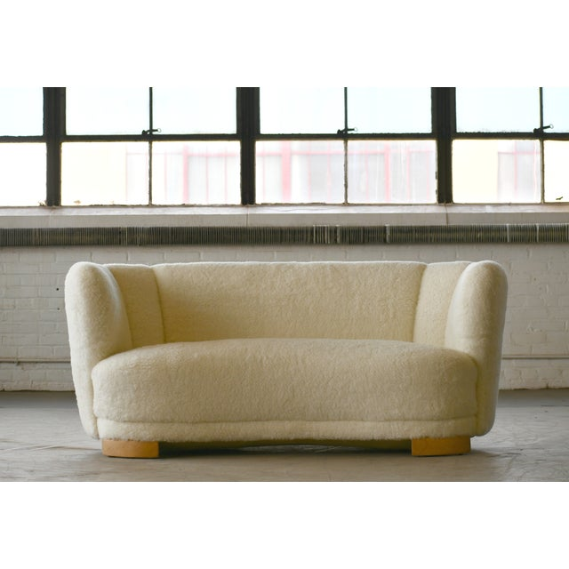 Viggo Boesen style banana shaped or curved sofa reupholstered in new lambswool made by Slagelse Møbelværk in the 1940s....