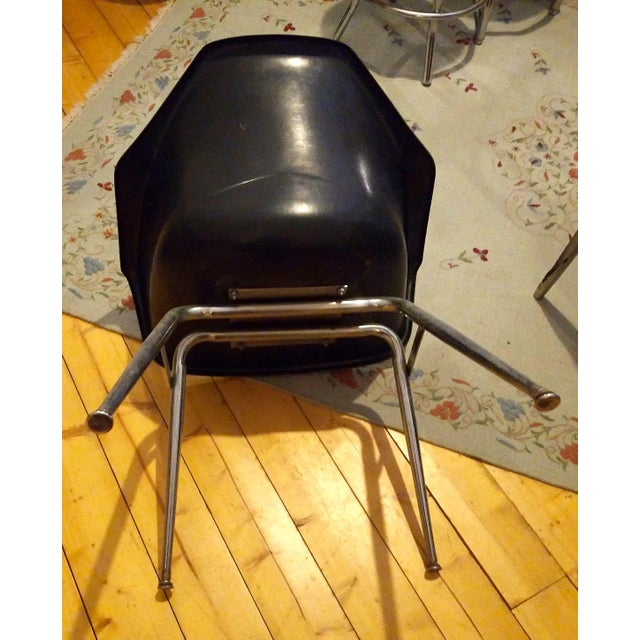 Mid century Eames popular shell style armchairs in great condition. Black with gentle and stylish curved arms, very...