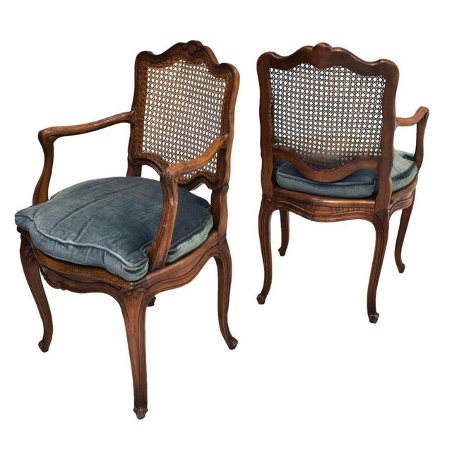 A pair of elegant, small French Louis XV style walnut armchairs, late 19th to early 20th c. Both in excellent condition,...