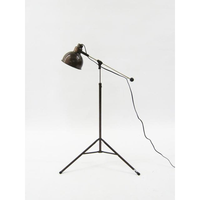 This highly functional industrial floor lamp has great construction and detailing. Adjustable in height, the arm extends...