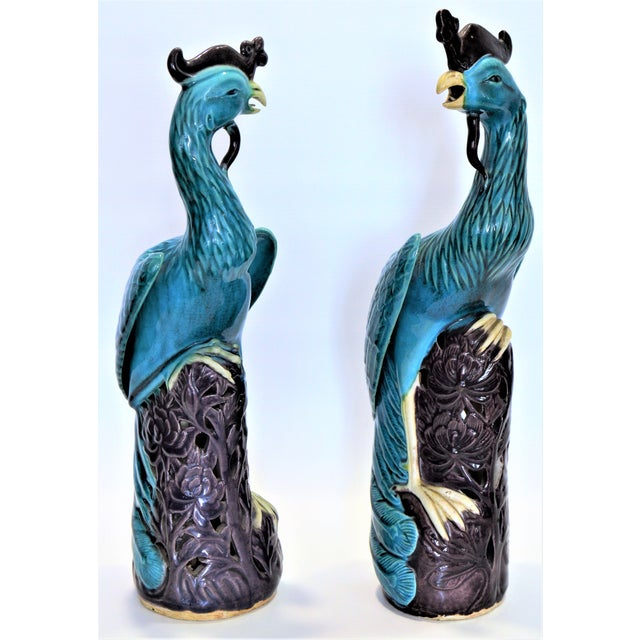 Offering a rare large pair of antique Chinese porcelain pair of phoenix, circa 1940s. These phoenix sculptures or...