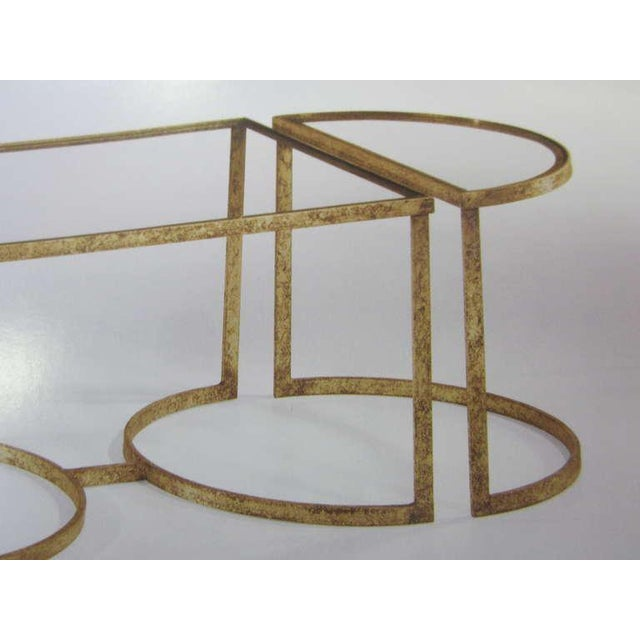 Elegant Italian Mid-Century Modern neoclassical style coffee table in gilt iron with three parts that can be configured to...