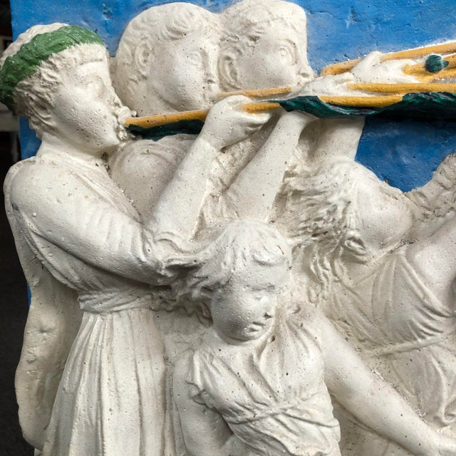 Another place, another time... This decorative antique plaster frieze with cherubs was purchased from an estate in Maryland.
