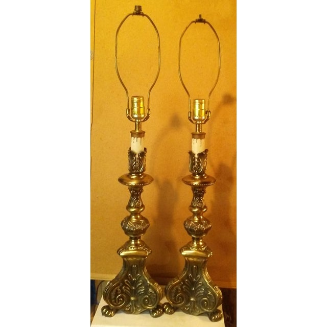 Pair of bronze candlestick style electric table lamps. Ornate lamps with 3 claw feet. Very nice set of lamps. Does not...