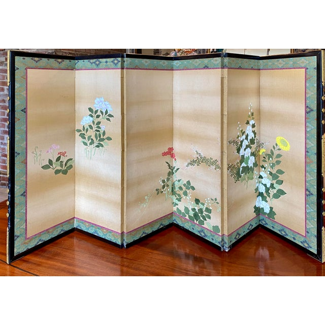 Late 19th century 6-panel table screen with vibrant summer flowers painted on silk. Beautiful brass hardware on edges....