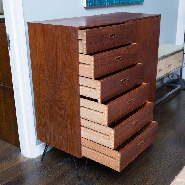 Clean 70s era teak dresser with a ton of storage by danish designer Arne Iversen for Vinde Mobelfabrik. Dresser sits on...