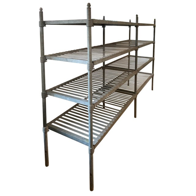 A fantastic early 20th century French industrial galvanized zinc shelving unit from a commercial kitchen or bakery with...